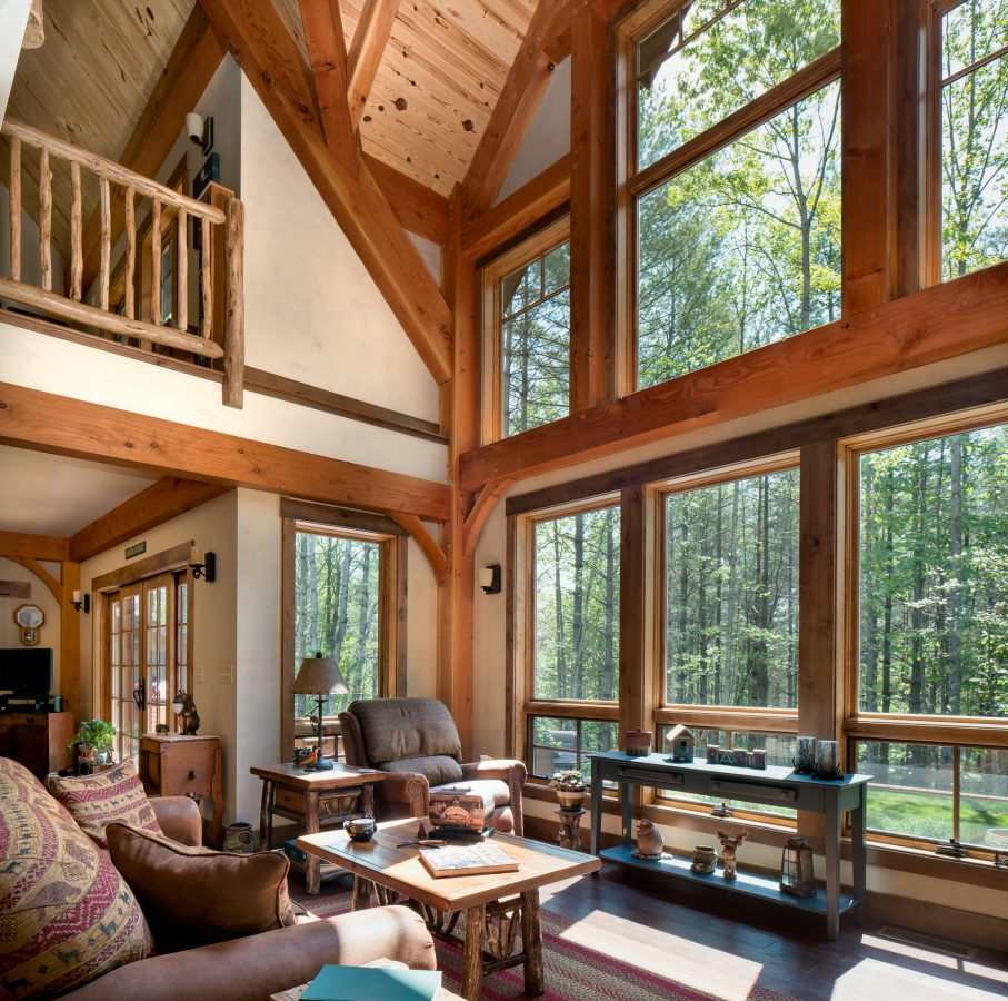 Rustic retreat custom timber frame home timberframe horizons for Rustic timber frame homes
